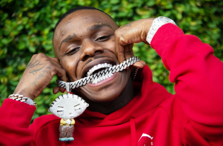DaBaby is wearing a red hoodie.